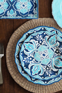 Le Cadeaux dinnerware is our go-to for alfresco dining. Available at Blue Peacock Home. 978.468.1228